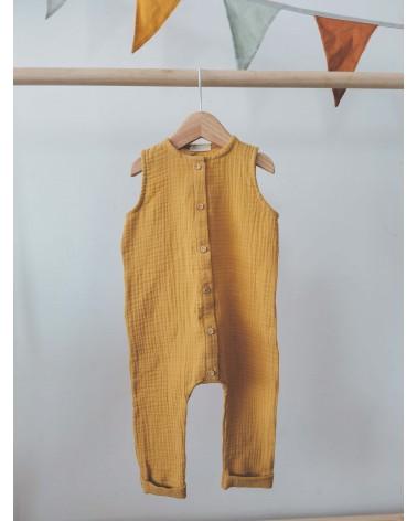 Mono largo en muselina de algodón orgánico, color mostaza.